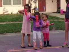 Future Run Club members Cara, Maddie and Cassie Wenz enjoy throwing color on the runners.