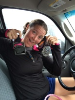 Dana Thomas has medals to show off for both the Hospital Hill 5K and 10K.