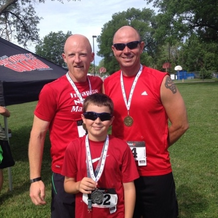 Dustin Danner (at right)(with son Mason and friend Mike Tipton) finished first in his age group at the Gooseberry 5K in Trenton, Mo. on June 21. Dustin's 23:33 finish also earned him third place overall. Mason finished second in his age group.