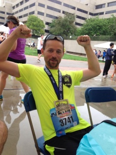 Russell Wenz displays his medal earned in the Hospital Hill Half Marathon.