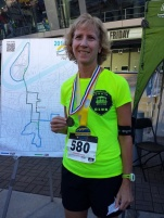 Linda Pasalich earned an extra medal by placing first in her age group at the Broadway Bridge Run 10K.