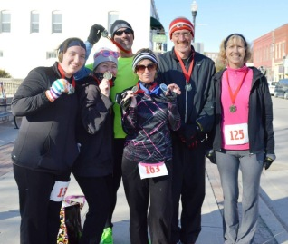 Shelly Byrd earned first place overall in the women's division, along with a crowd of run club members who won first place in their age division.