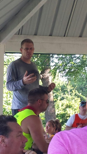Matt Hartwig, a board member of the Excelsior Springs Educational Foundation, ran in the Waterfest 5K then spoke to runners during the awards ceremony about the work of the foundation.
