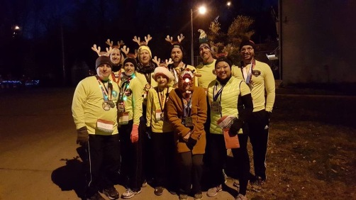 Members of the Fishing River Running Club served as reindeer (and elves) to lead Santa's sleigh in the annual Excelsior Springs Christmas Parade.